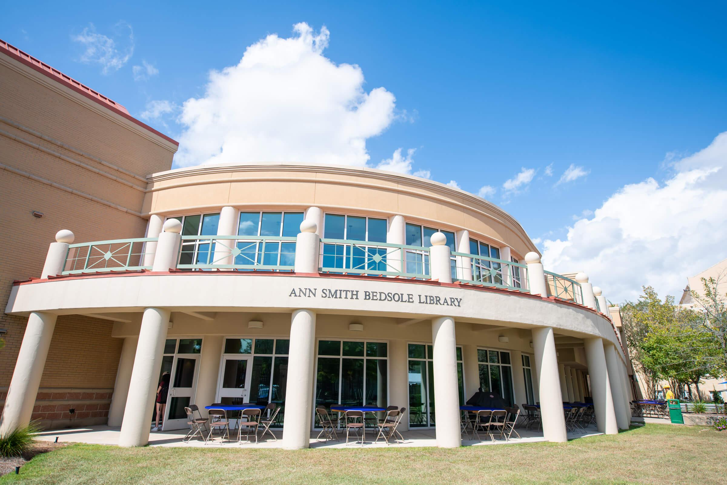 Wideangle photo of the Ann Smith Bedsole Library exterior